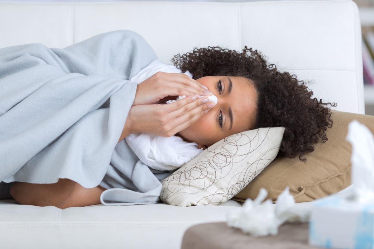 Woman Sniffling Sick with the Flu {what to do if you have the flu}