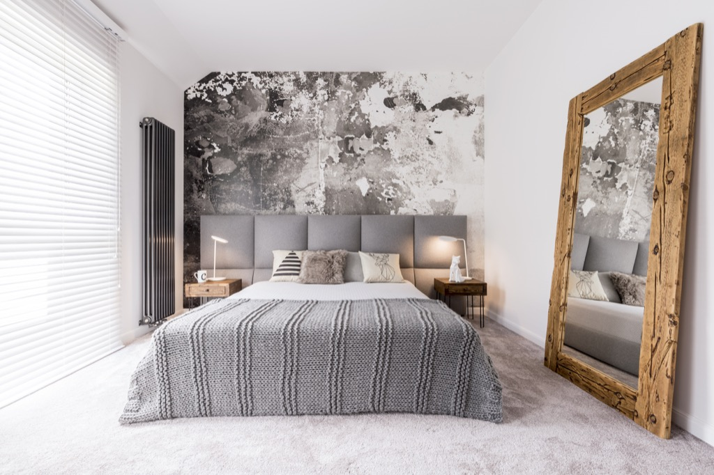 small well designed monochromatic modern bedroom with a wooden mirror against the wall, Joanna Gaines tips