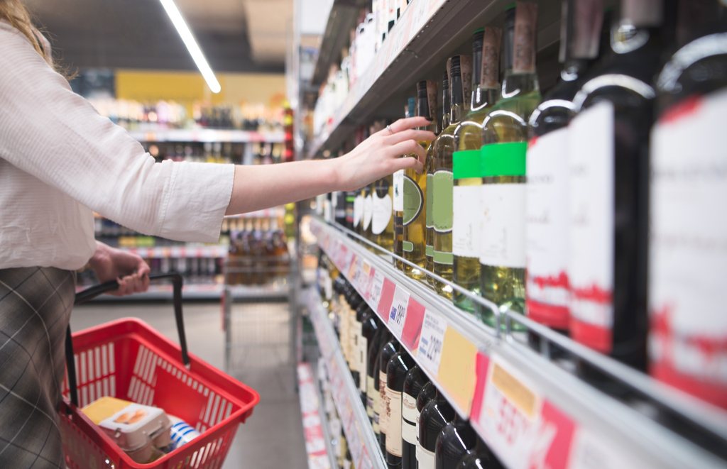 woman buying wine at a supermarket