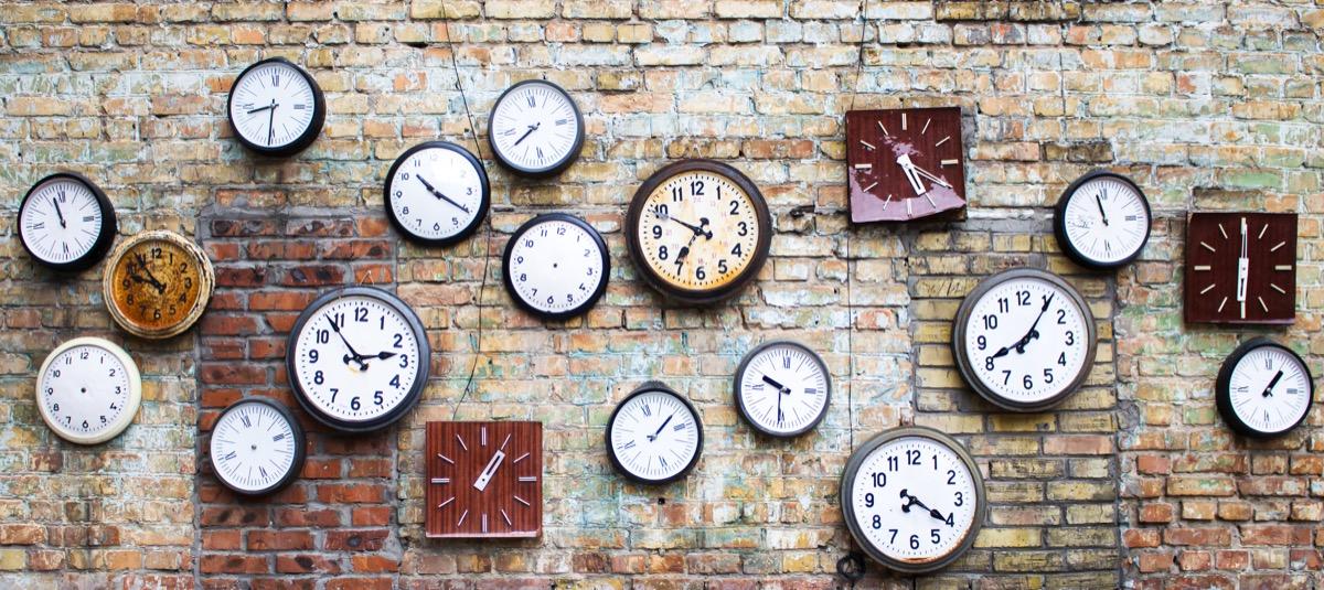 Wall of vintage clocks