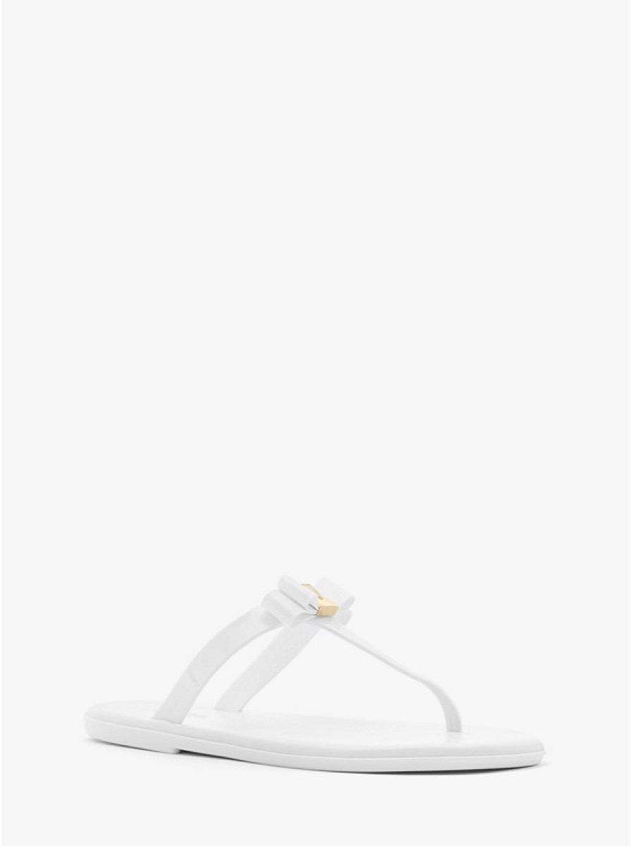 white flip flops with a bow