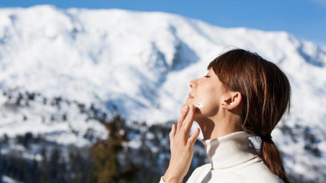 Woman Applying Sunscreen health tweaks over 40