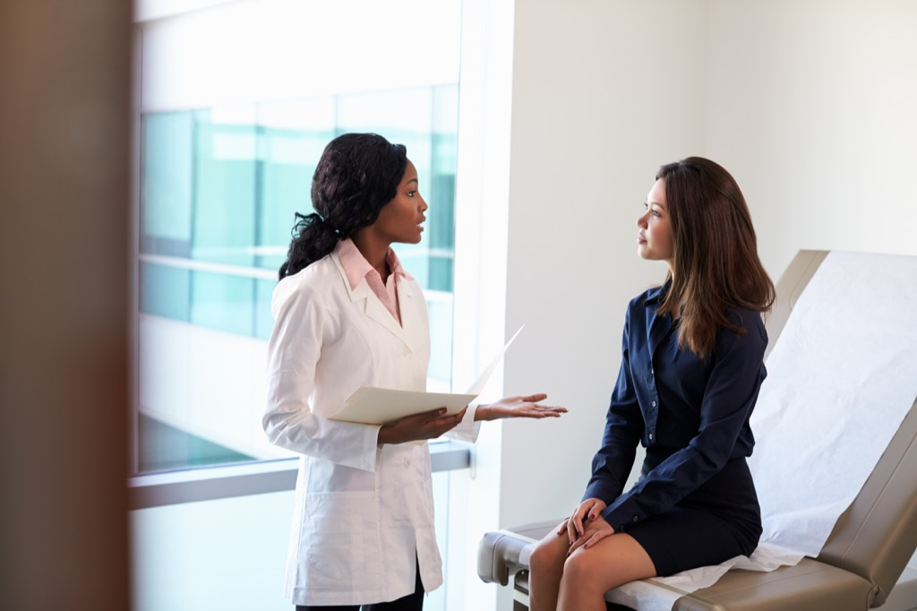 doctor talking to a female patient at a checkup