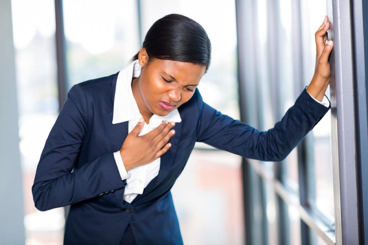 Woman Experiencing Chest Pain {Surprising Flu Symptoms}
