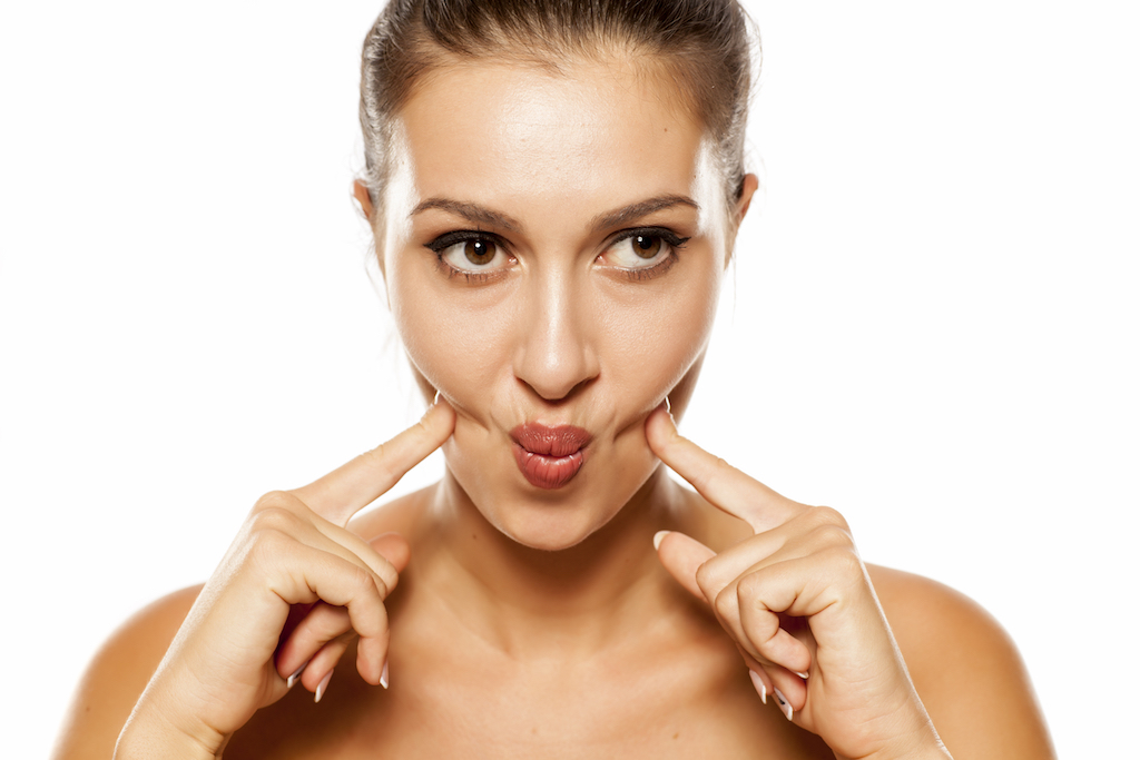 Woman Doing Facial Exercise Anti-Aging Tips You Should Forget