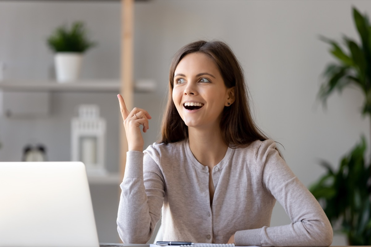 Woman excited as a she finally thinks of the answer