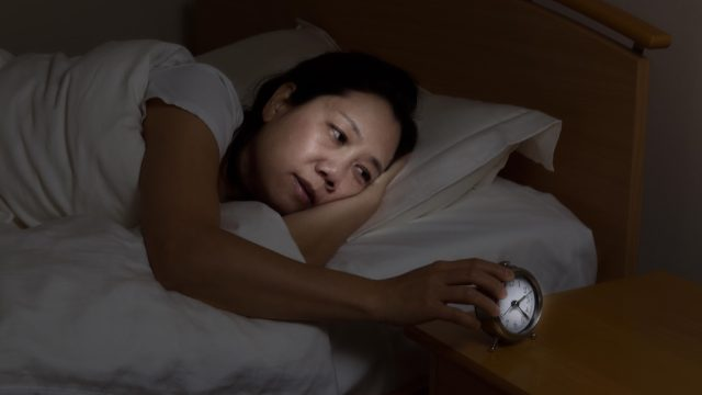 woman with insomnia, signs you need a new mattress