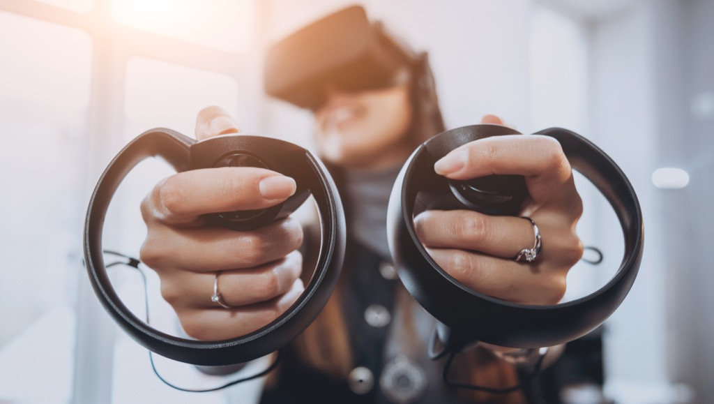 woman playing with a virtual reality headset