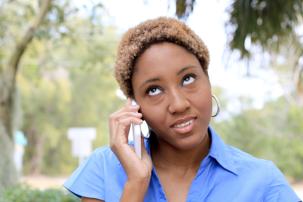 Woman Rolling Eyes on Phone Worst Things to Say to Customer Service