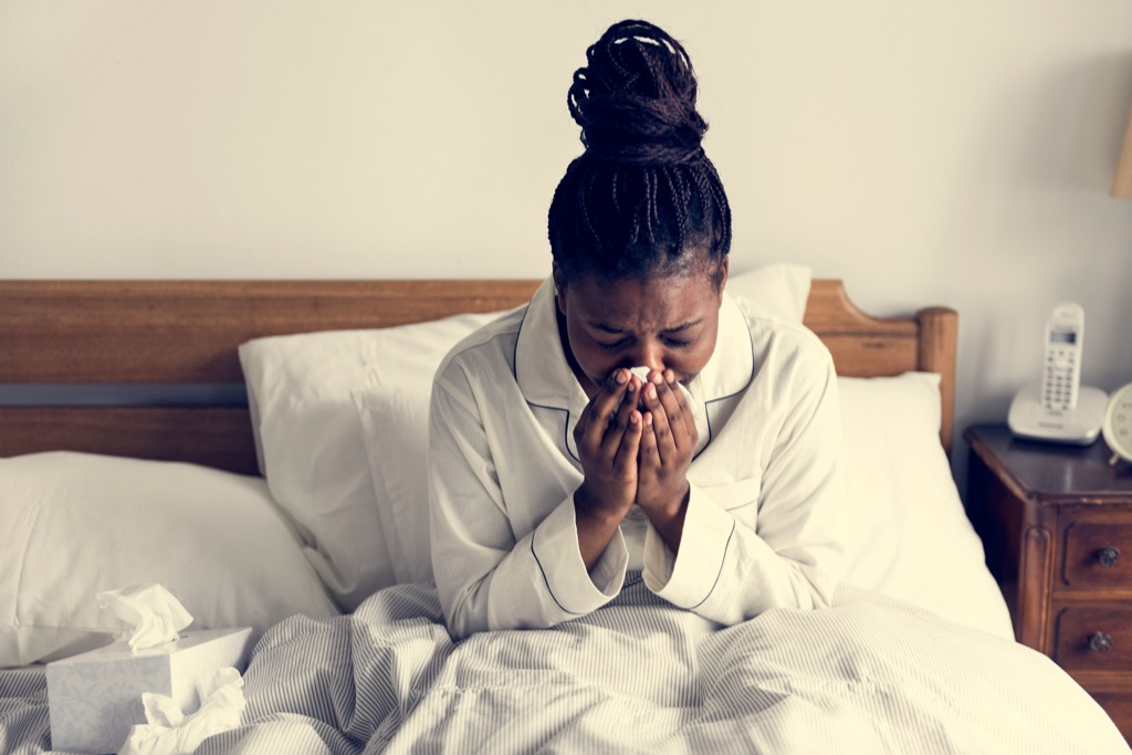 woman sick in bed exposed to serious flu risk