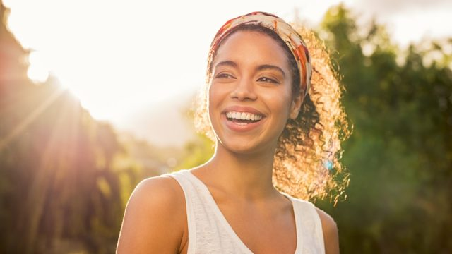 woman smiling to improve her life