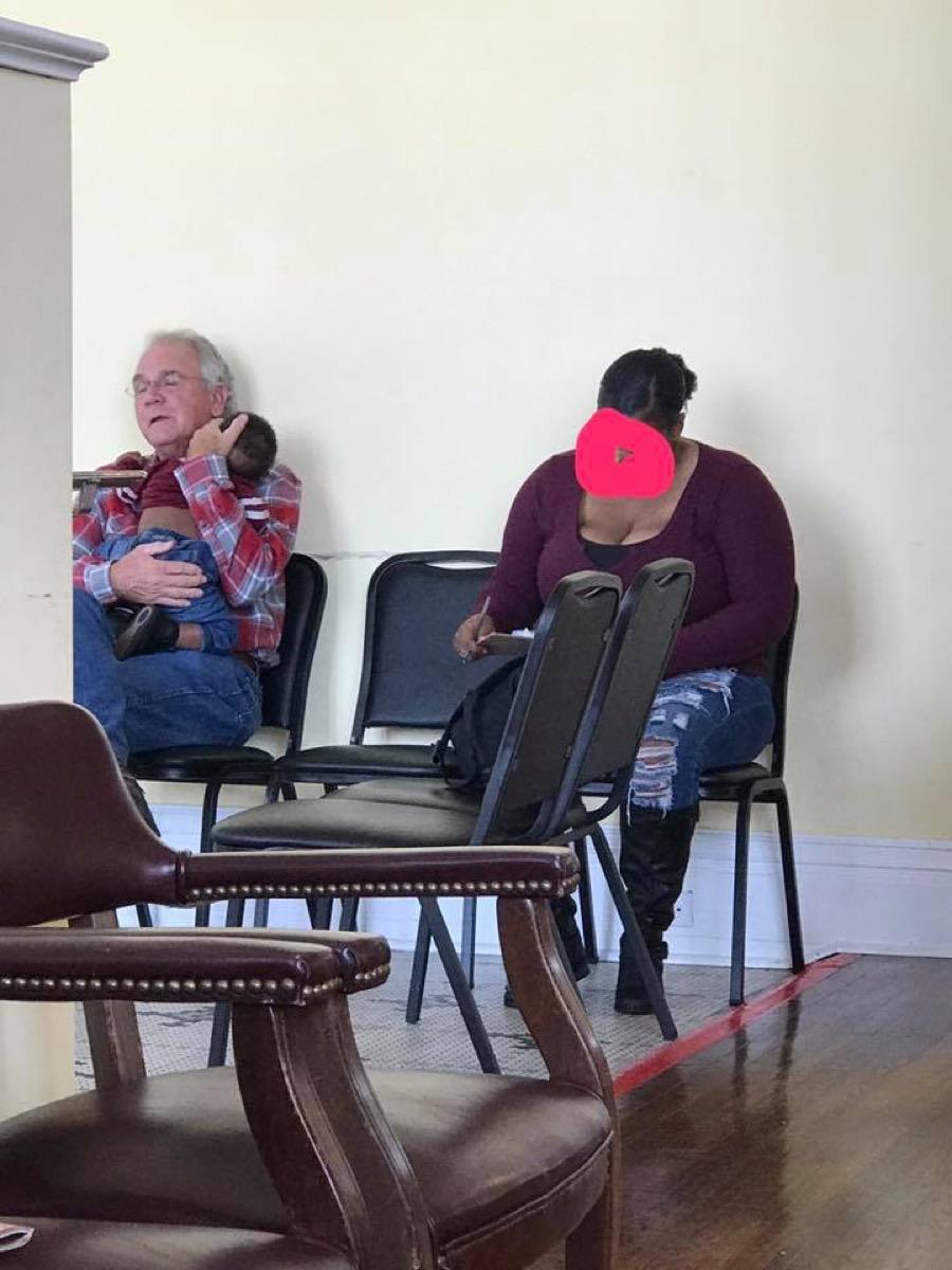 Stranger Comforts Baby Waiting Room
