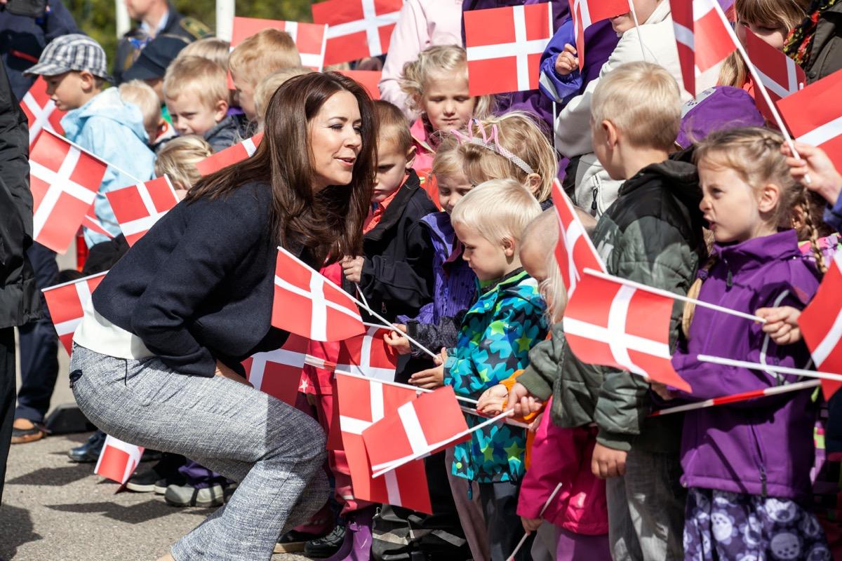 Children holding Denmark flags