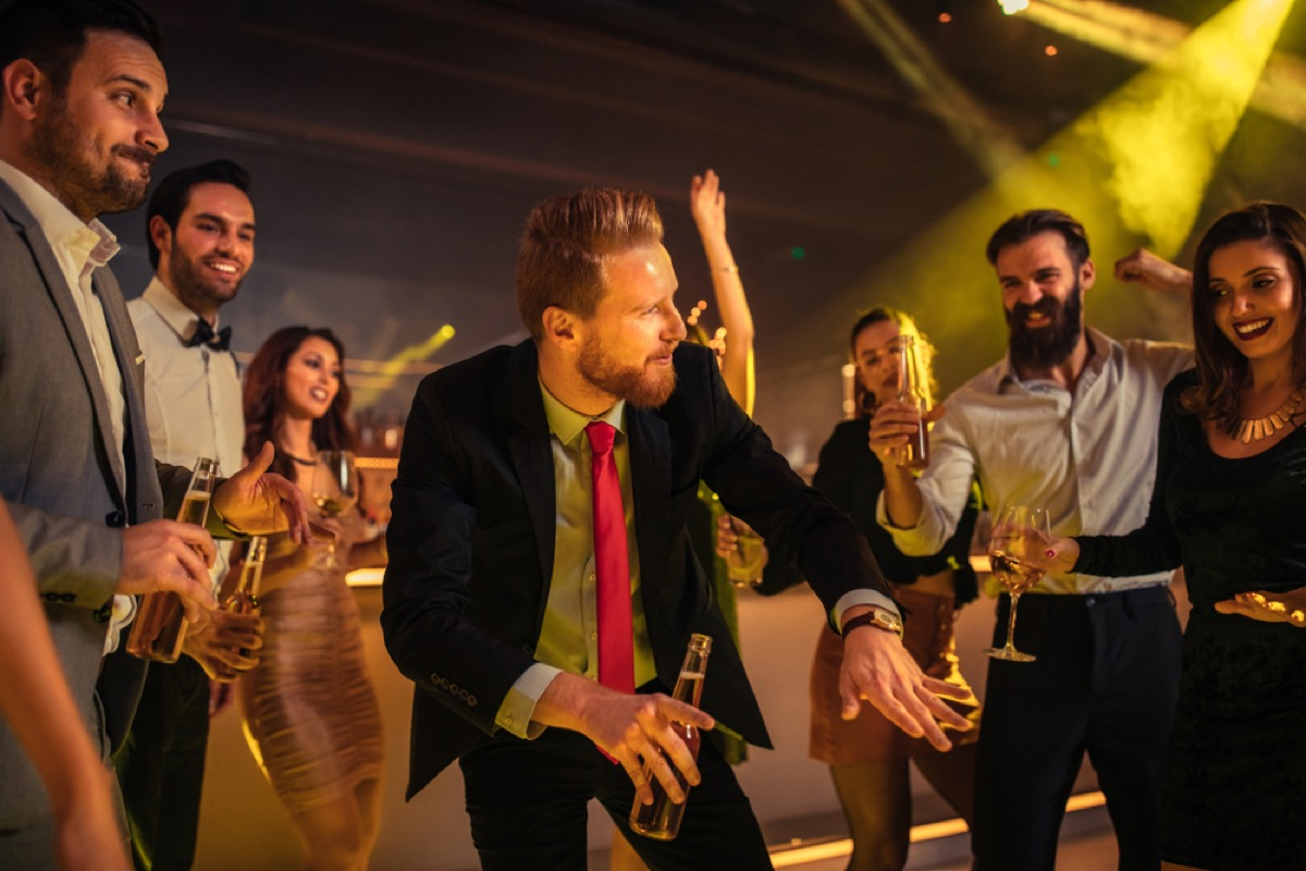 annoying guest dances at holiday party