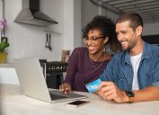 Happy multiethnic couple making online payment