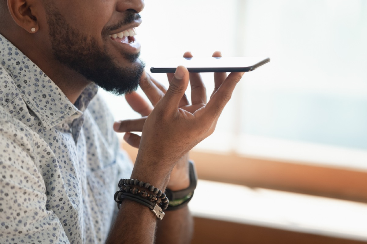 black man talking on speakerphone, rude behavior