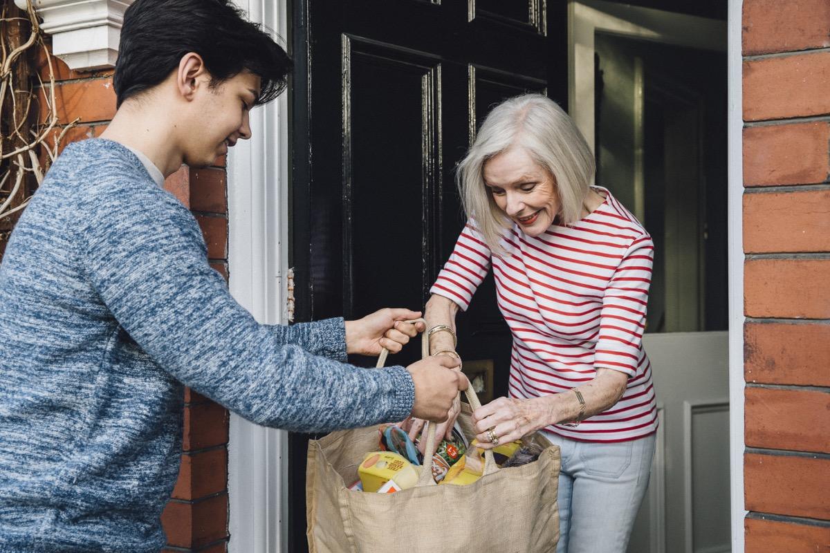 boy helping elderly women with groceries, ways to feel amazing