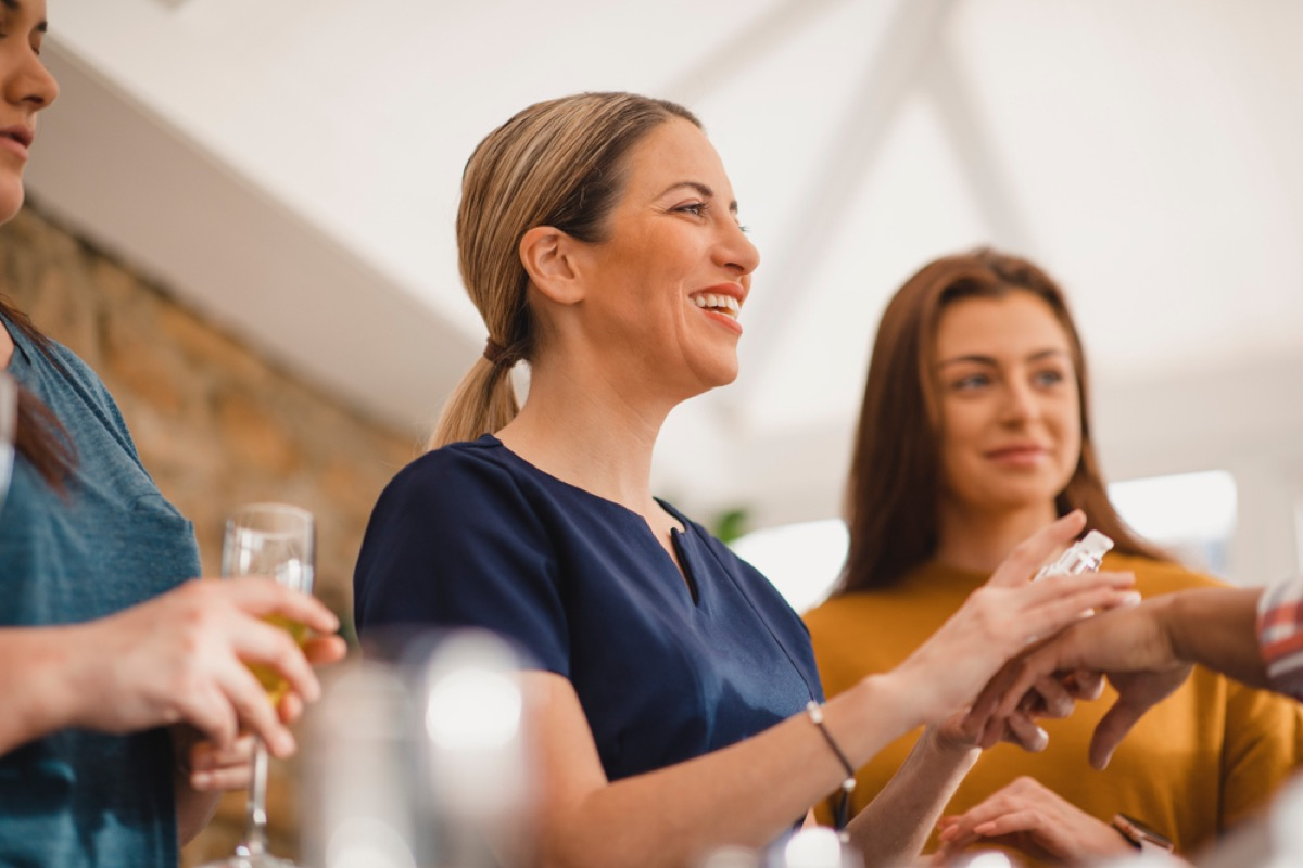 women drink champagne while shopping