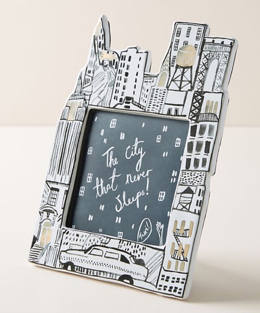 white and black picture frame with nyc skyline
