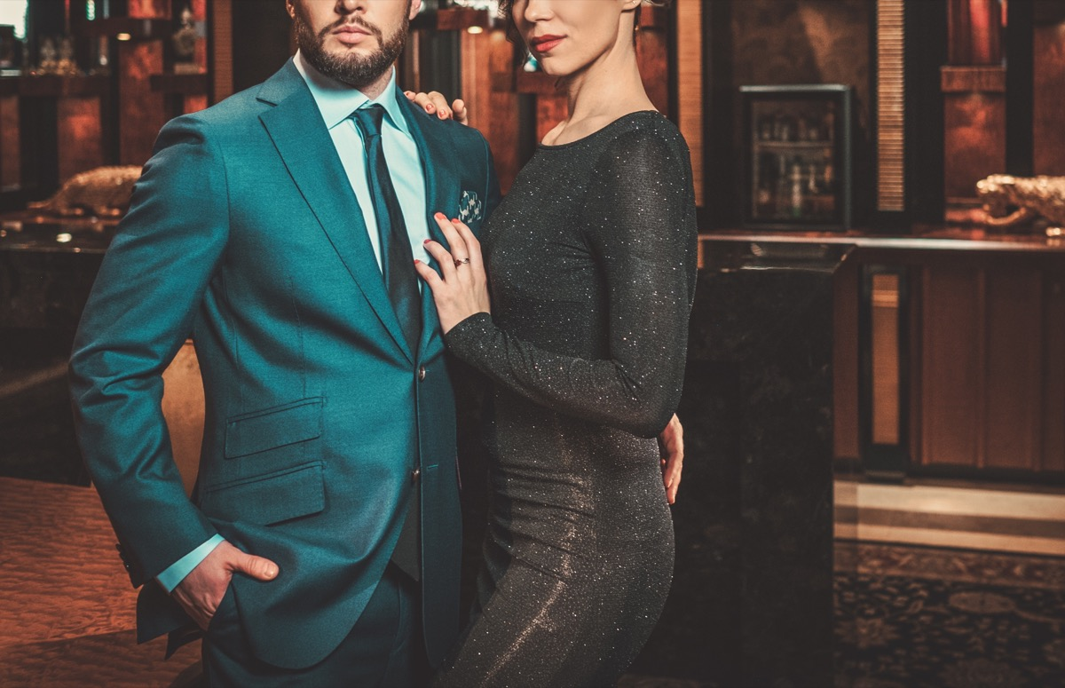 man in a fancy suit with a woman in a fancy cocktail dress