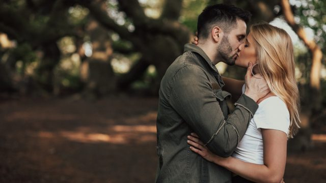couple kissing in the woods - why do we close our eyes when we kiss?