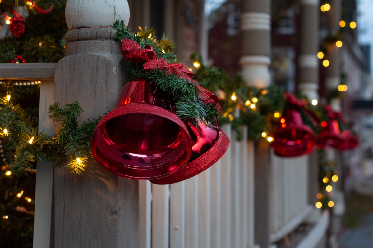 a home banister full of holiday decorations