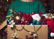 woman holding a box of christmas decorations