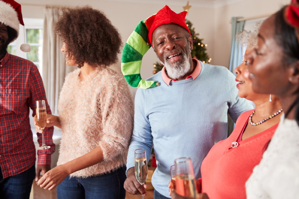 black family celebrates christmas during holiday party