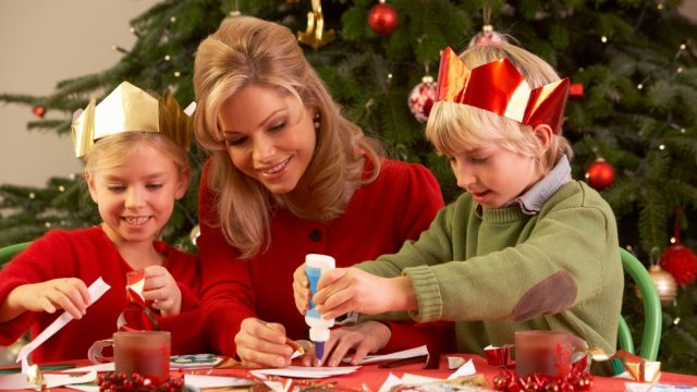 Family making holiday decorations