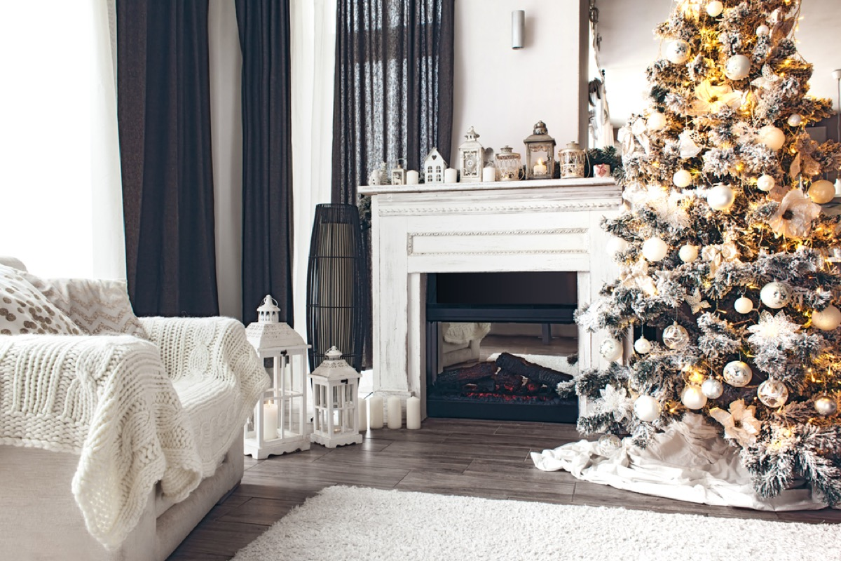 a christmas tree in a white living room christmas tree decorating tips