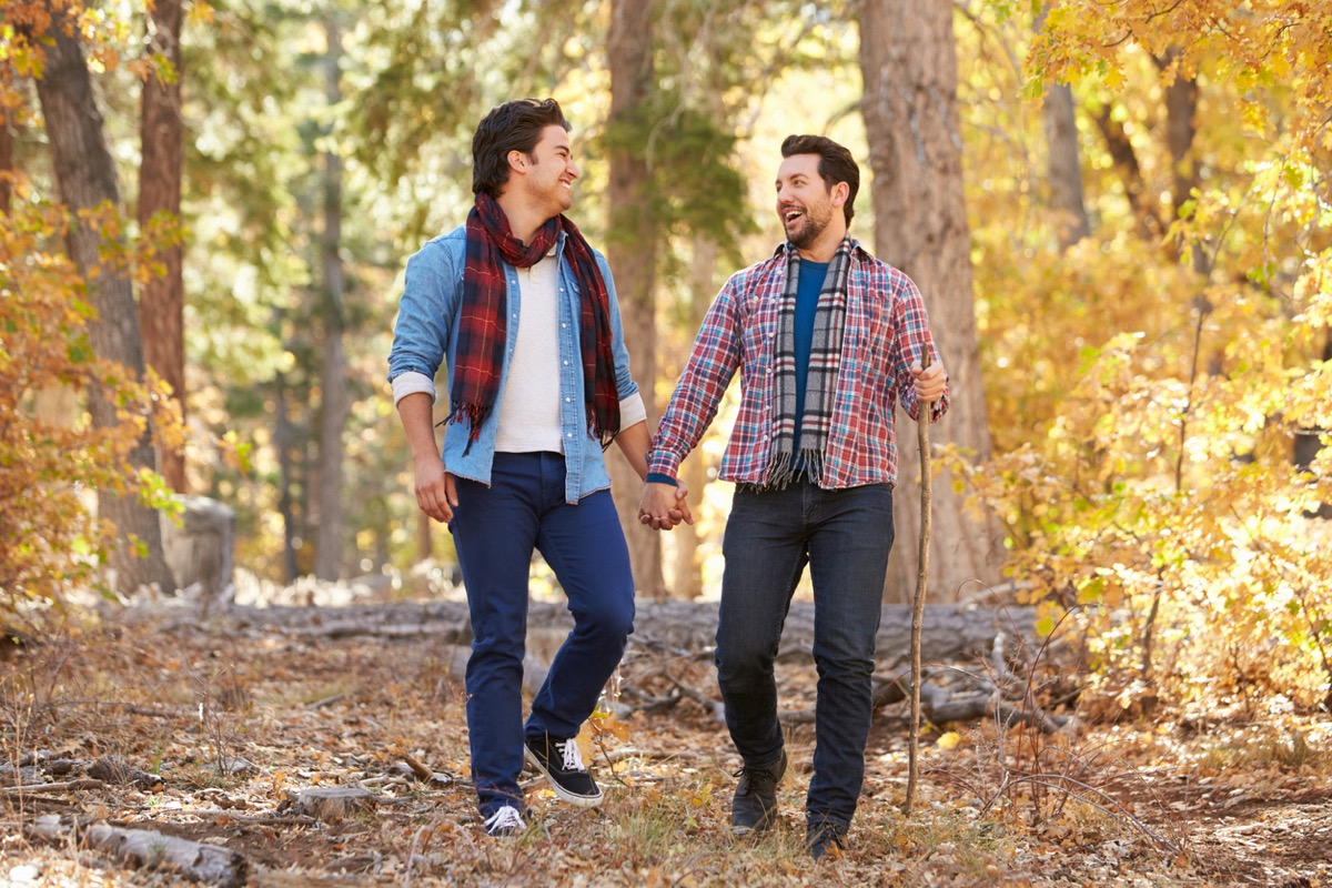 Gay Male Couple Walking and Hiking Through Fall Woodland Together