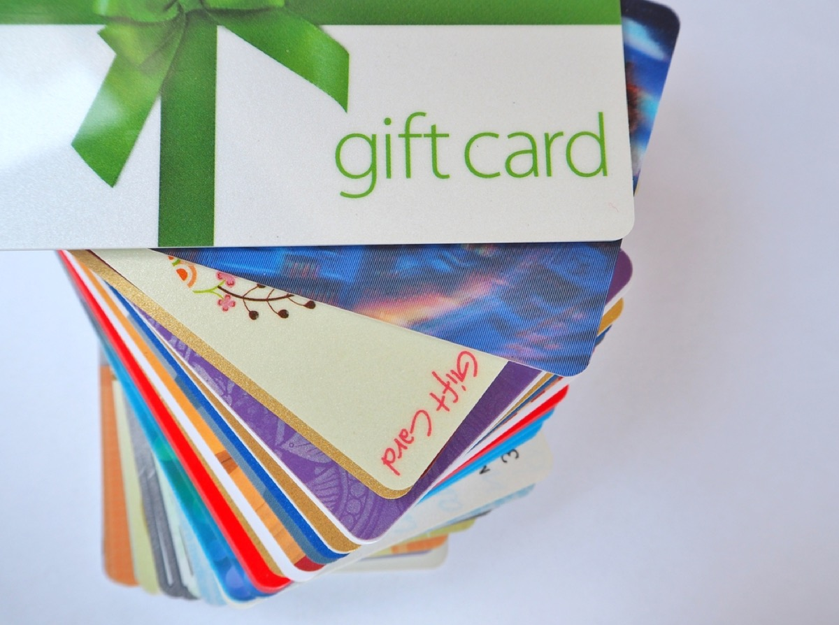 fanned out pile of over a dozen gift cards