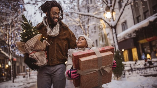 a young family preparing to give back this holiday season with presents in hand