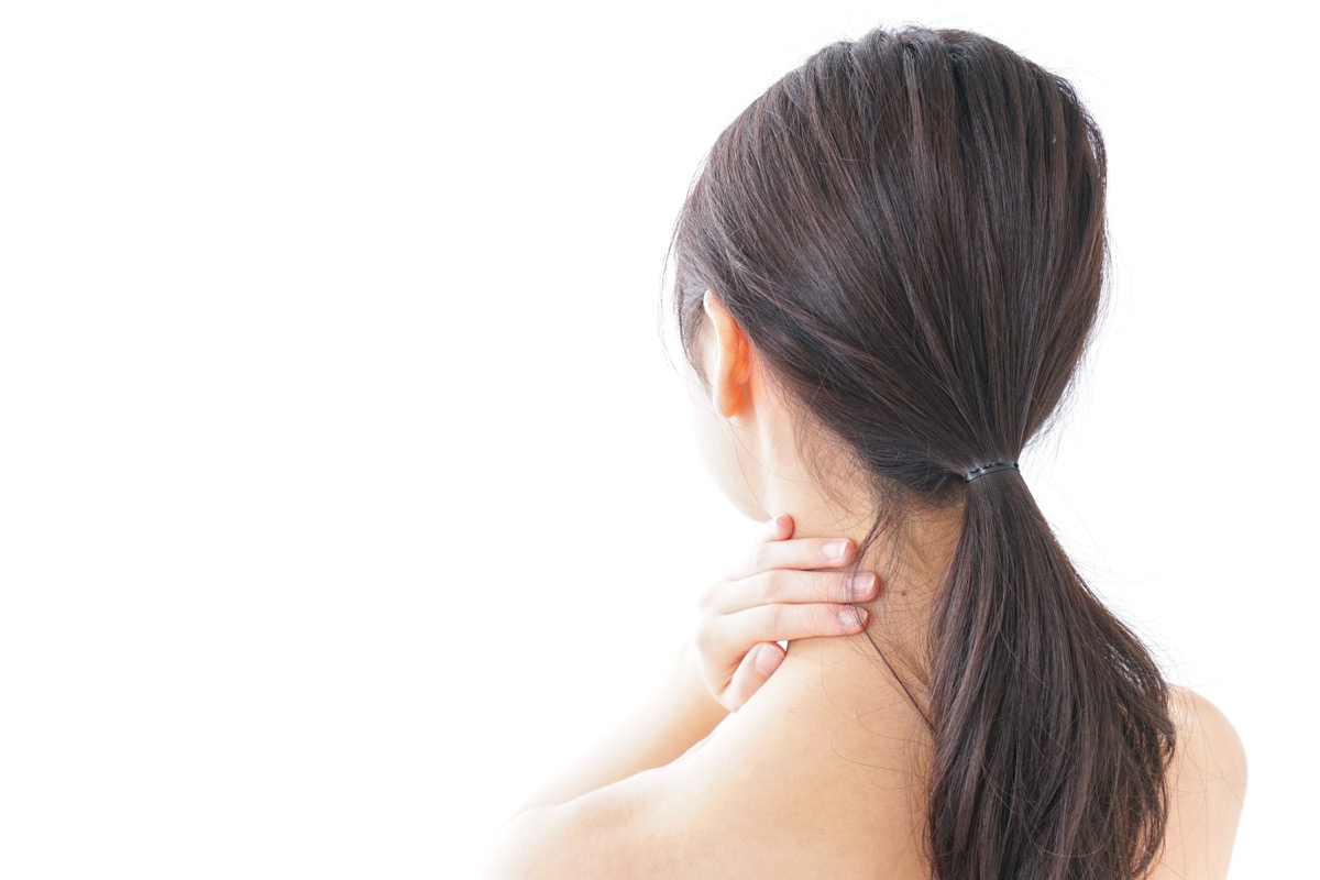 Woman with her Hands on her Neck, subtle symptoms of serious disease