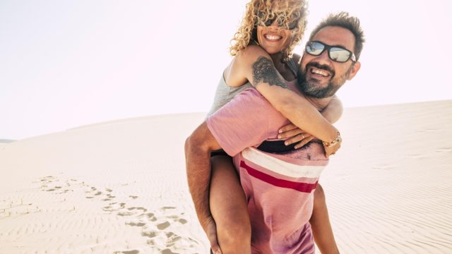 Happy couple over 40 in the desert enjoying themselves on adventure