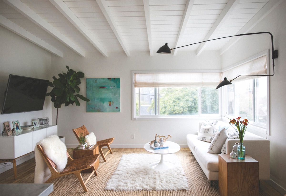 modern home with shag rug, leather chairs, and white shag pillow