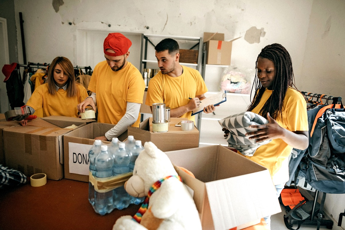 homeless shelter workers packing boxes