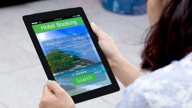 woman books hotel reservation online