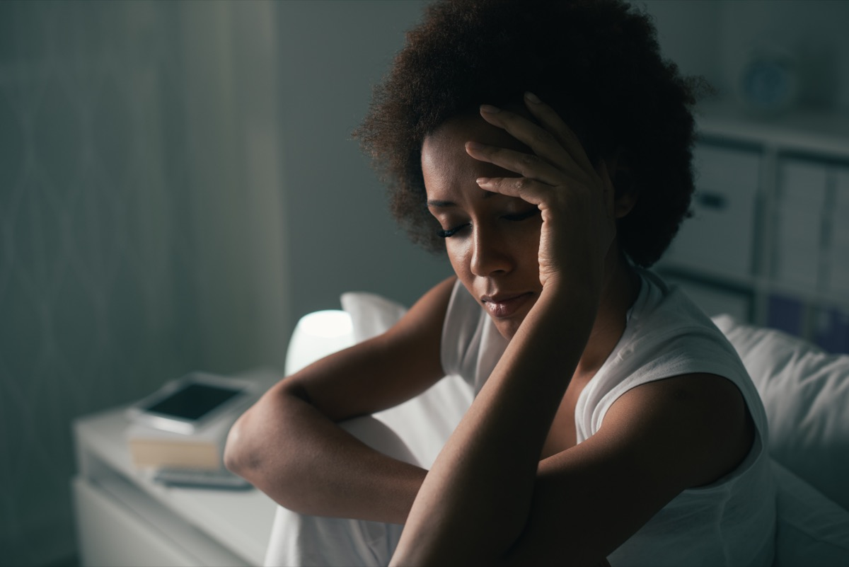 Woman can't sleep suffering from insomnia stressed