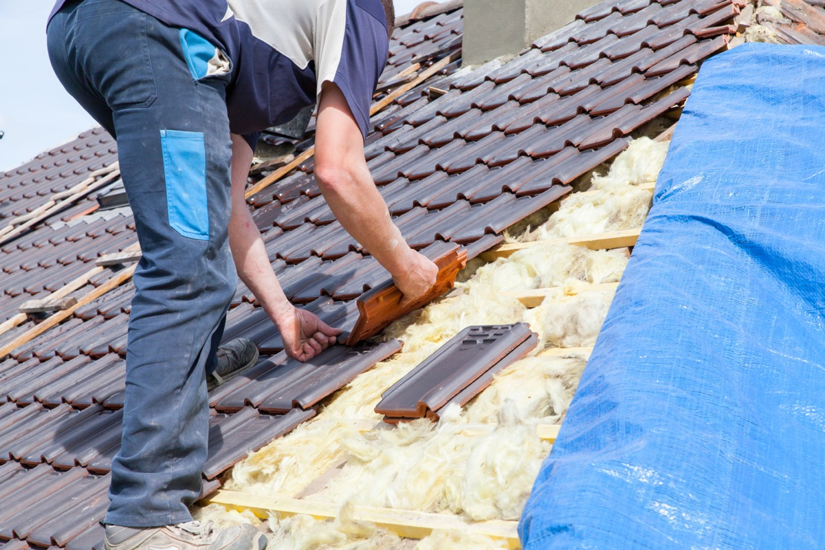 Man Installing a New Roof home upgrades with best return