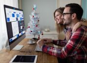 Man and woman working hard and staying productive over holiday
