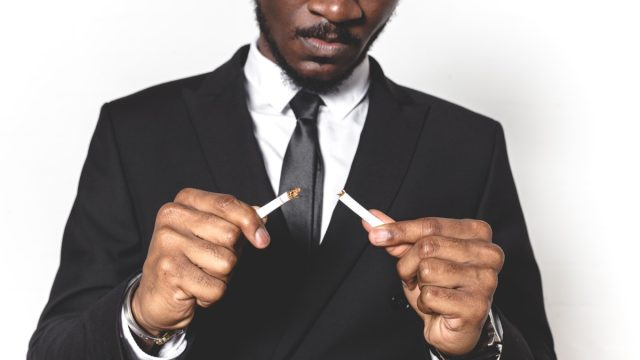 African american man breaking a cigarette because he is done smoking
