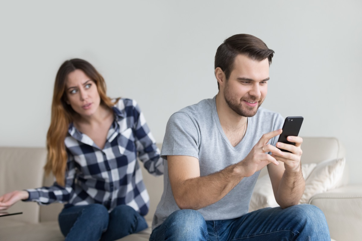Man ignoring his wife because he's too distracted by his phone