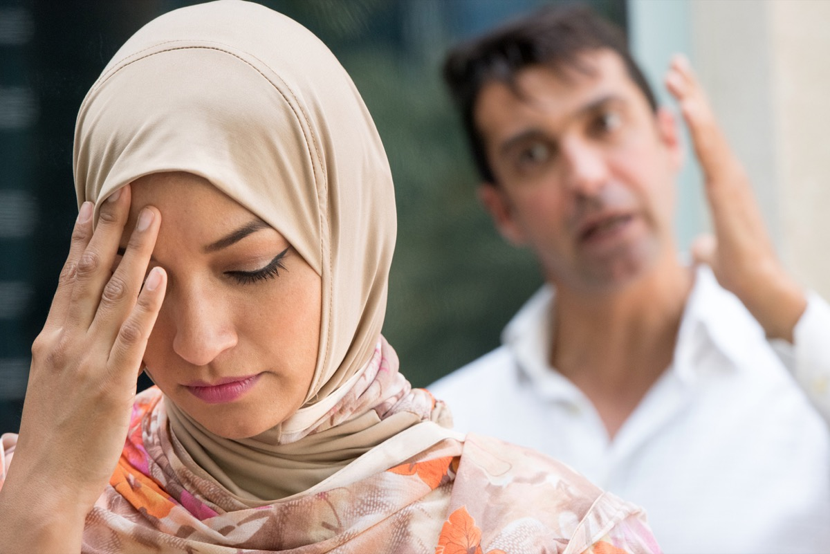 Muslim woman and man arguing