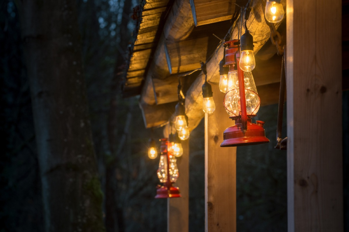 home exterior with red storm lanterns and twinkly lights