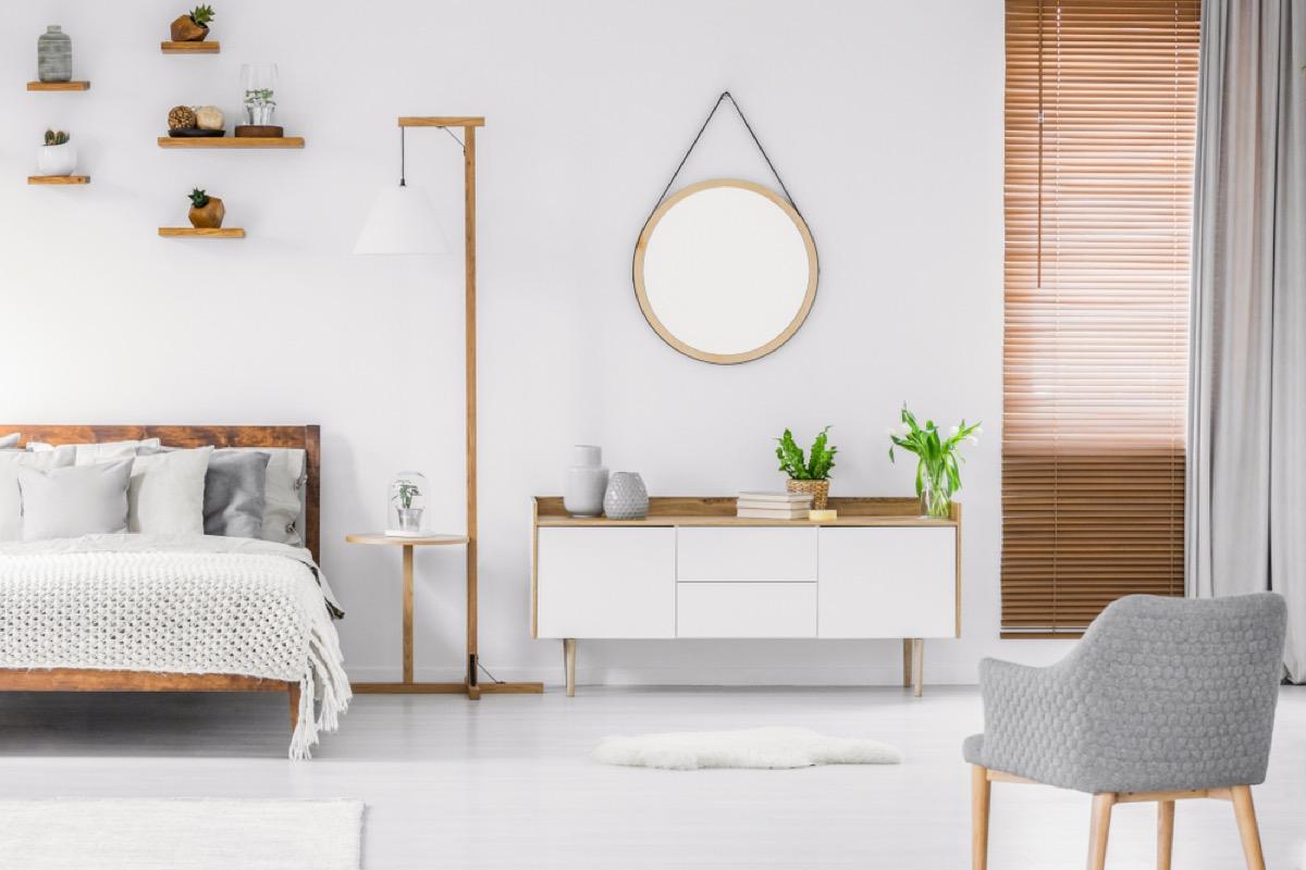 round mirror on wall in scandinavian minimalist room