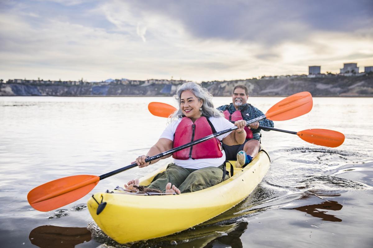 A beautiful senior Mexican couple kayaking