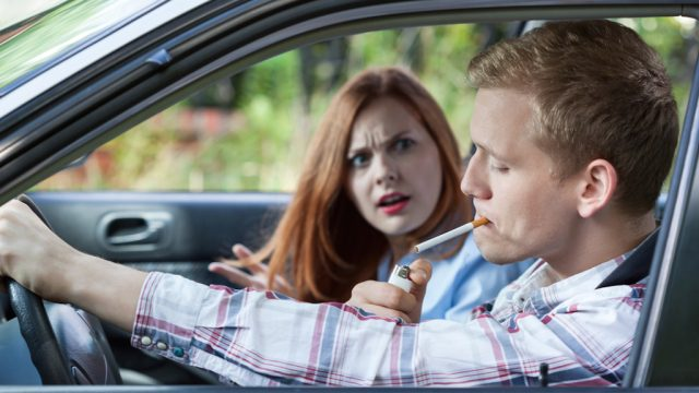 smoking man annoyed woman