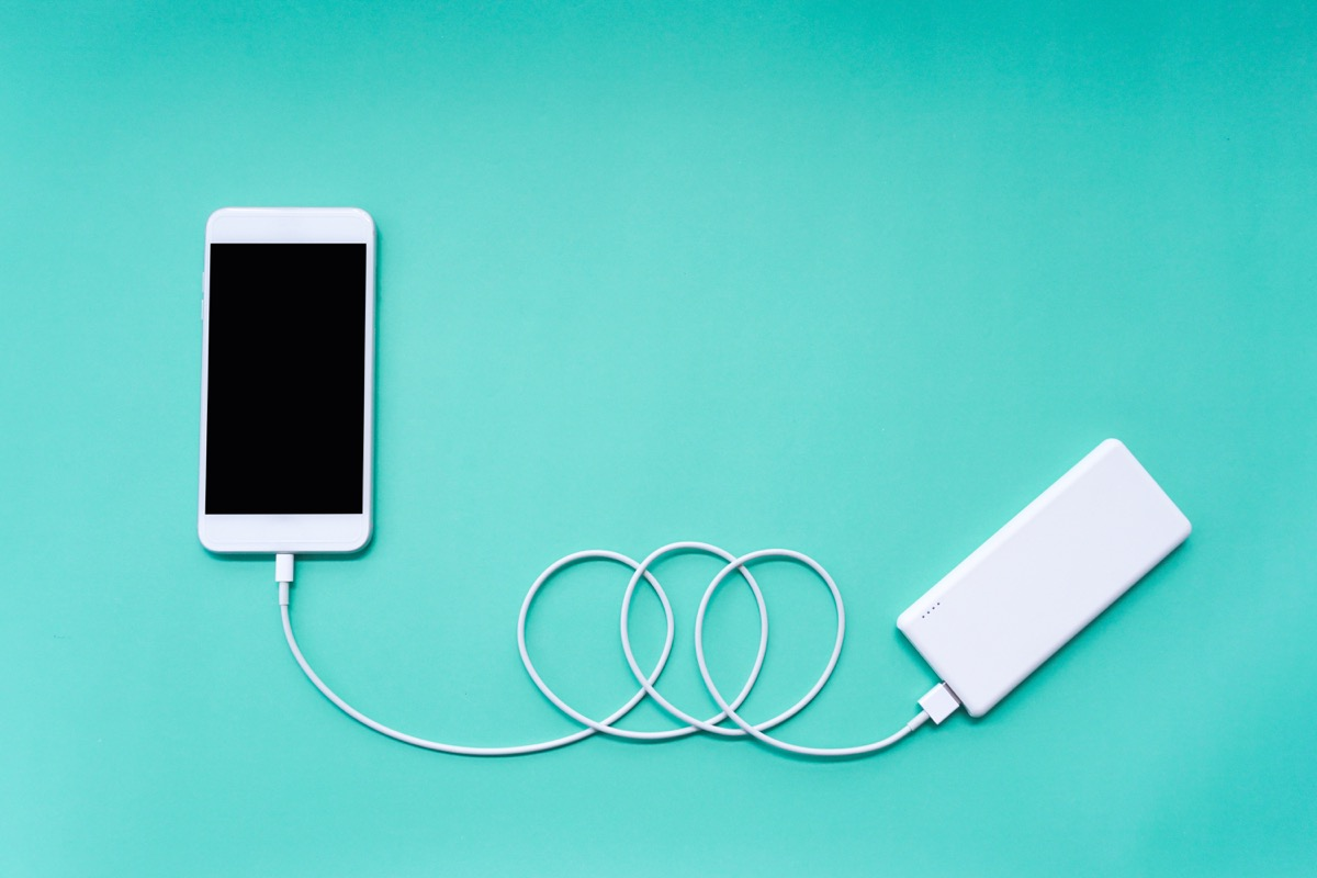 a smartphone charging with a portable cell phone charger obsolete home items