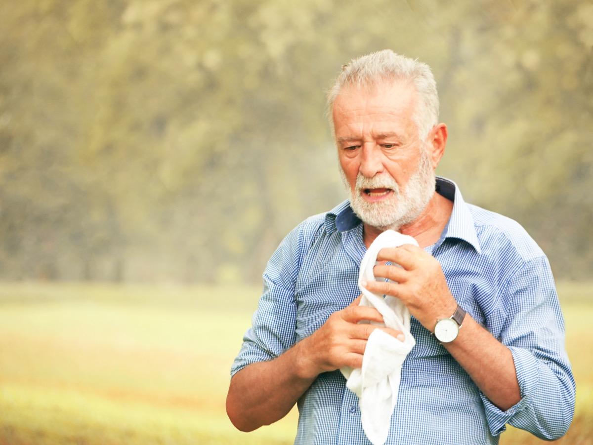 Man experiencing symptoms of stroke